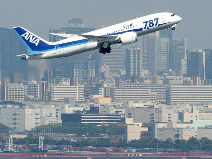 An All Nippon Airways Boeing 787 Dreamliner flies over Tokyo Bay during a test flight on April 28. ANA has successfully conducted its first test flight of the aircraft since battery problems grounded the planes worldwide earlier this year.
