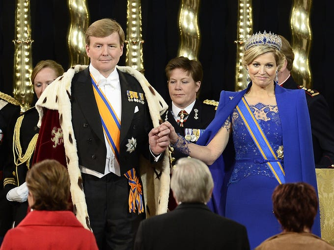 King Willem-Alexander of the Netherlands, left, and Queen Maxima attend his inauguration after the abdication of Queen Beatrix at New Church on April 30 in Amsterdam. Willem-Alexander became the first Dutch king in more than a century after his mother, Beatrix, abdicated after 33 years as the Netherlands' queen.