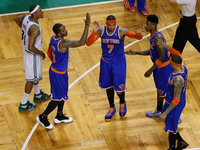 Game 6 in Boston: Knicks 88, Celtics 80 - Carmelo Anthony is congratulated by J.R. Smith, Iman Shumpert and Kenyon Martin.