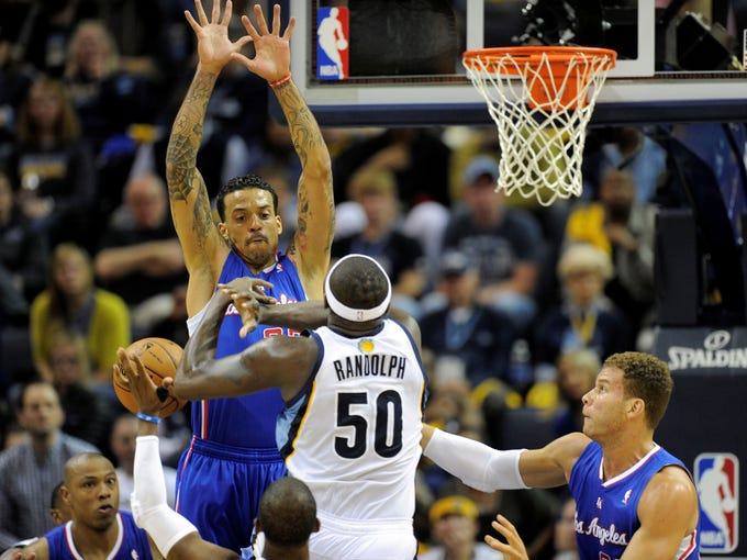 Game 6 in Memphis: Grizzlies 118, Clippers 105 - Grizzlies forward Zach Randolph goes up for a layup against Matt Barnes and the Clippers' defense.