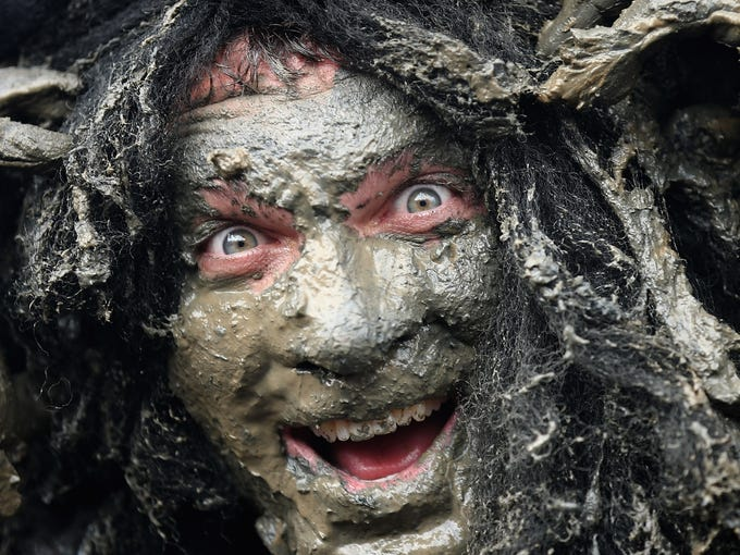 "Joel Hicks, who was raising money for the ""Always With a Smile"" charity, takes part in the Maldon Mud Race in Maldon, England, on May 5."