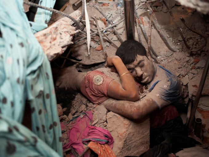 This haunting photograph of victims embracing amid the rubble of a garment factory building collapse in Bangladesh was taken by Taslima Akhter, a Bangladeshi photographer and activist. She felt compelled to cover the garment factory collapse as she had been documenting the plight of garment workers.