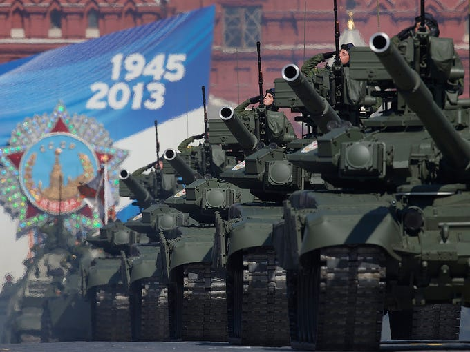 Russian tanks drive down Red Square during a Victory Day parade on May 9 in Moscow. The parade celebrates the defeat of Nazi Germany during World War II and honors military personnel and civilians who died during the conflict 68 years ago.