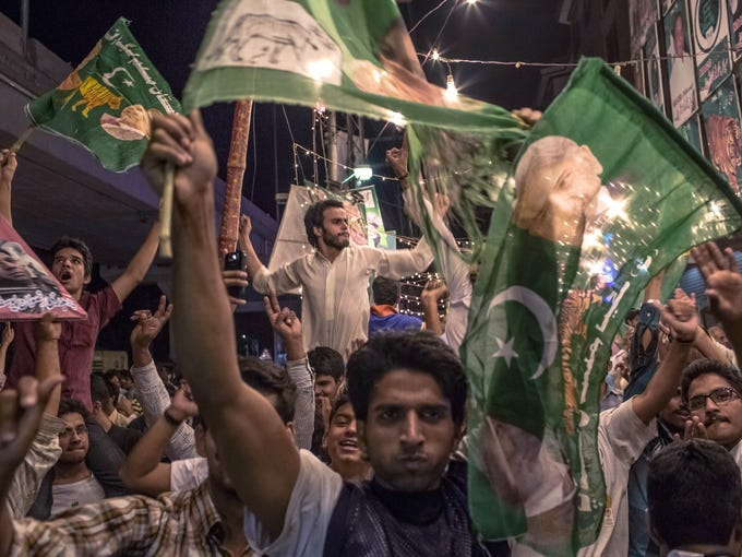 Supporters of Pakistan Muslim League-N (PML-N) celebrate election results in front of a party office late on May 11, 2013, in Lahore, Pakistan. Millions of Pakistanis cast their votes in parliamentary elections. It is the first time in the country's history that an elected government will hand over power to another elected government.