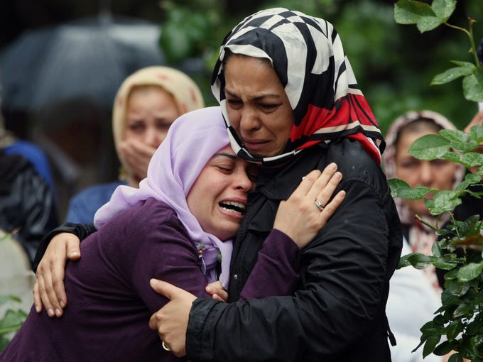 Mourning relatives cry during the burial for one of the 46 victims killed in Saturday explosions in Reyhanli, near Turkey's border with Syria, on May 12. The bombings on May 11 marked the biggest incident of cross-border violence since the start of Syria's bloody civil war and has raised the fear of Turkey being pulled deeper into the conflict.