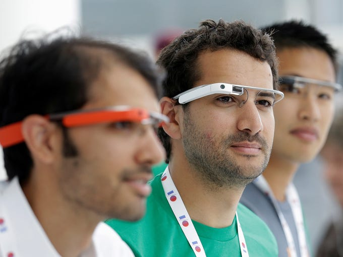 Google Glass team members wear Google Glass. Google kicked off its Google I/O developer conference on Wednesday in San Francisco.