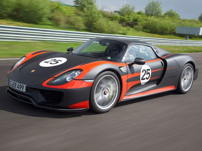 Porsche has unveiled the 918 plug-in hybrid high-performance supercar, which has a all-wheel drive, a 6.8 kW battery and electric motors front and rear and a 4.6-liter, eight-cylinder engine putting out 608 horsepower. The constuction is aluminum and carbon fiber.