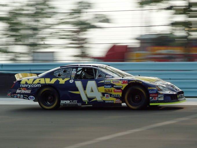 Watkins Glen International: A Dodge Charger passes through the final turn.