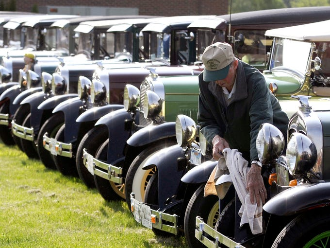Ron Hoffman, of Bad Axe, Mich., dusts off his Model A Ford, one of the owners who brought their Model A's to the grand opening vehicle last weekend of the world's largest Model A Ford museum on the campus of the Gilmore Car Museum in Hickory Corners, Mich., in a building based on the design of a 1928 Ford dealership.