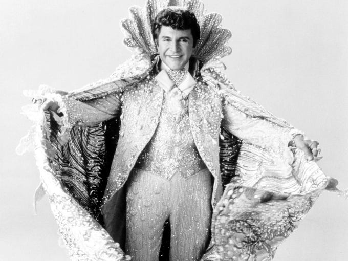 "In HBO's 'Behind the Candelabra,' Michael Douglas and Matt Damon play Liberace and his young lover. The film, says Douglas, is a tribute to ""the love they had for each other."" Here's a look at the real Liberace, at one point the most famous entertainer in the world, and the actor who plays him. In this shot, he poses in one of his elaborate costumes."