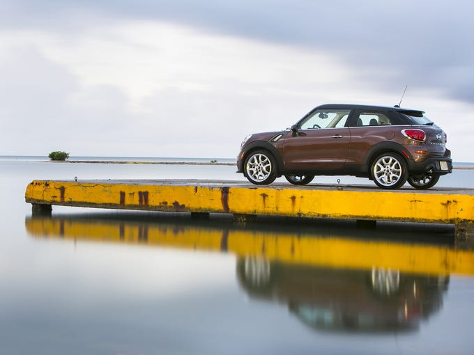 The  Mini Cooper Paceman.  A two-door version of the Countryman, slightly more mainstream than other Coopers for broader appeal; front-wheel-drive, two door, four-passenger subcompact hatchback.