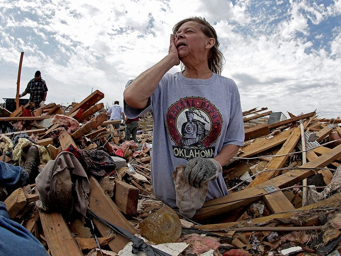 Carol Kawaykla searches for items in her destroyed home on May 23 in Moore, Okla.