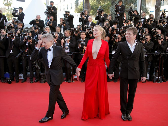 "Director Roman Polanski, left, arrives with actors Emmanuelle Seigner and Mathieu Amalric for the screening of Polanski's film ""Venus in Fur"" at the 66th international film festival, in Cannes, France, Saturday, May 25, 2013."