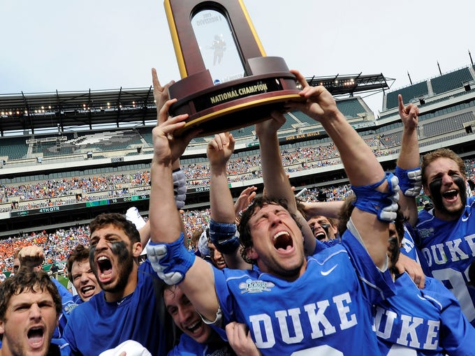 Duke lacrosse players celebrate their NCAA championship.