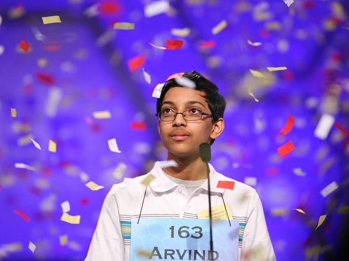 """Arvind Mahankali of Bayside Hills, N.Y., correctly spells """"knaidel"""" to win the Scripps National Spelling Bee on May 30 at National Harbor, Md."""
