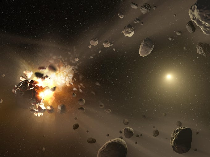This NASA artist's conception shows how families of asteroids are created. Over the history of our solar system, catastrophic collisions between asteroids located in the belt between Mars and Jupiter have formed families of objects on similar orbits around the sun.