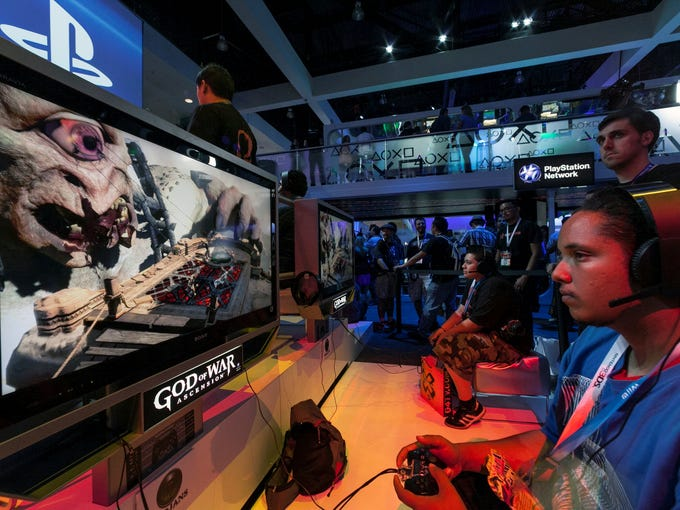 E3 attendee Christopher Hunter plays 'God of War: Ascension' at the Sony Playstation booth at E3 2012. While Xbox One and PlayStation 4 will dominate headlines at the 2013 Electronic Entertainment Expo, several blockbuster titles will appear at the video game showcase. Here's a look at the ones to watch.