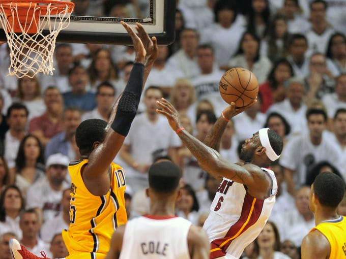 Game 7 in Miami: Heat 99, Pacers 76 - Miami Heat small forward LeBron James (6) puts up a shot over Indiana Pacers center Roy Hibbert (55).