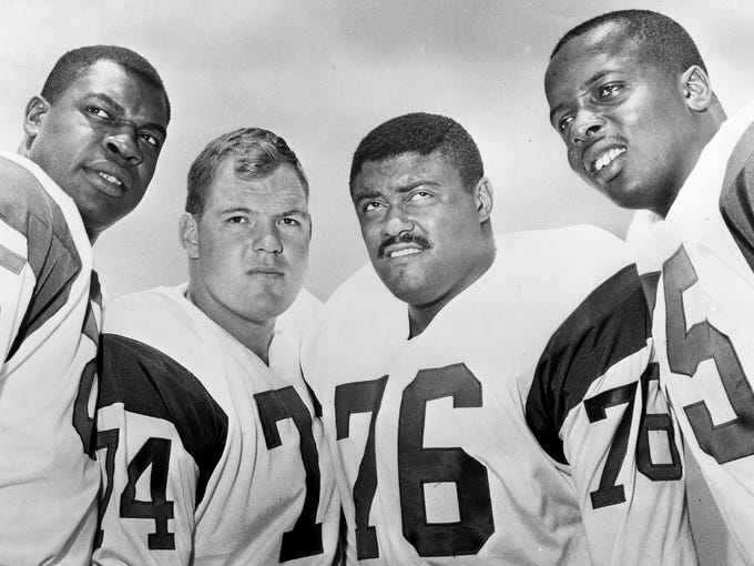 """This 1964 handout provided by NFL photos,  shows the Los Angeles Rams defensive front four, known as the """"Fearsome Foursome."""" from left to right are Lamar Lundy (85), Merlin Olsen (74), Rosey Grier (76), and Deacon Jones (75)."""