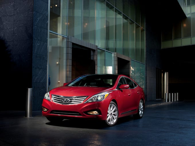 The 2013 Hyundai Azera. You can think of the Azera as a bigger, fancier Sonata and you'd be close enough. It's often compared to Toyota Avalon and Buick LaCrosse, which are about the same size.
