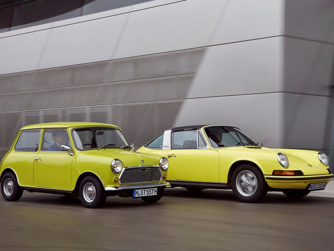 The longer Porsche is a neck ahead of the Mini, both in their vintage glory.