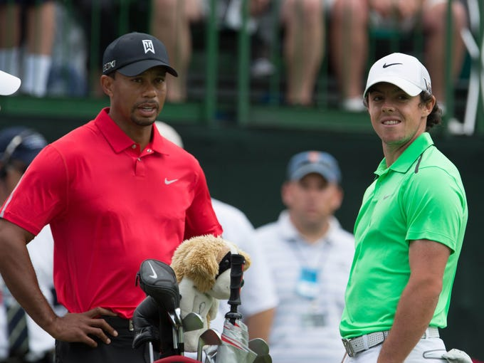 Tiger Woods speaks with Rory McIlroy on the tee of the 13th hole during the final round of The Memorial Tournament at Muirfield Village Golf Club in 2013.
