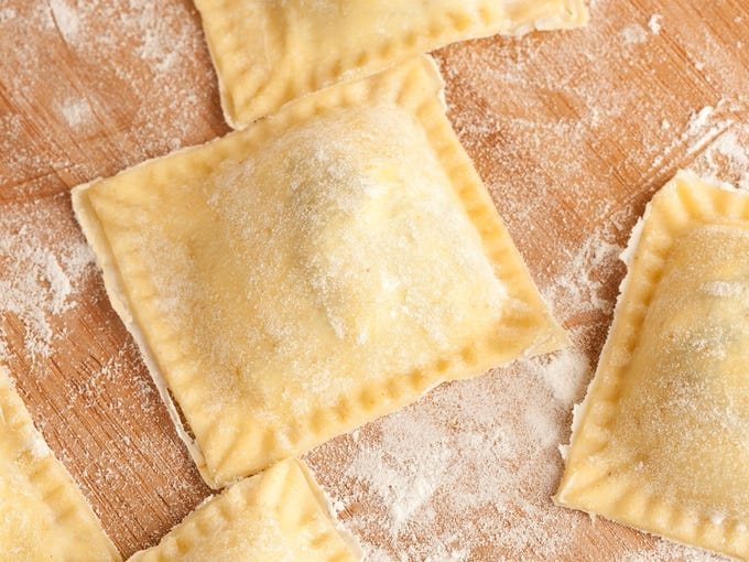 Italy: According to 'The Oxford Companion to Food,' the earliest references to ravioli appear in the writings of a Venetian merchant named Francesco di Marco dating to the 1300s. The earliest recipes fill dough with blanched green herbs and fresh cheese, and don't vary much from what you'll find in Italian restaurants nowadays. Today, most ravioli are produced in factories and sold frozen, but plenty of Italian artisans and home cooks alike still prepare them in the traditional way.