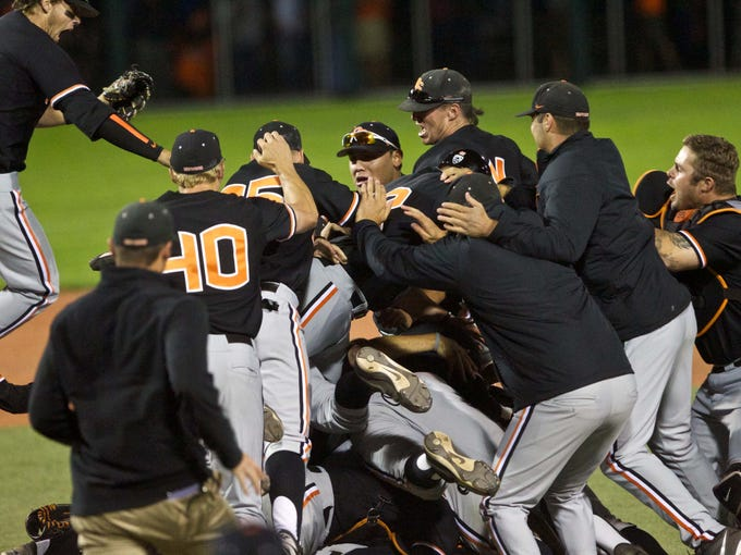 Oregon State Beavers players celebrate after defeating the Kansas State Wildcats 4-3 in the Corvallis Super Regional at Goss Stadium to advance to the College World Series.
