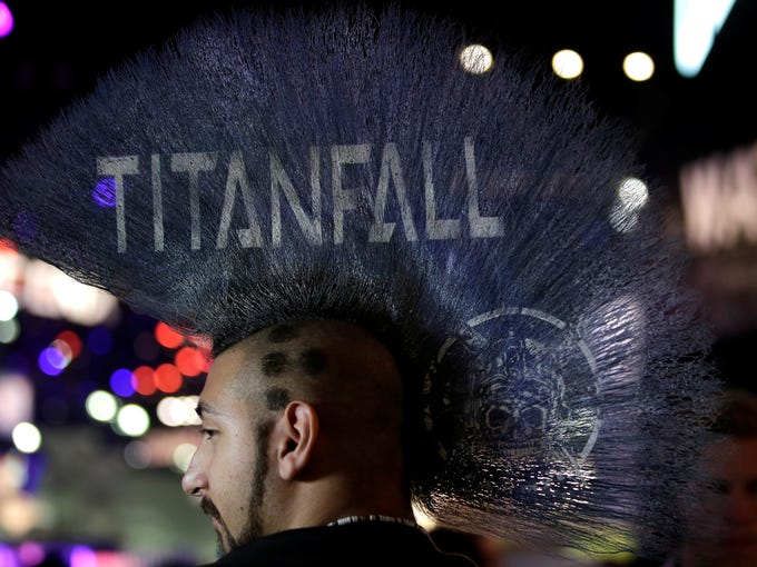 Ryan Hakik sports a Mohawk hairdo with the title of the video game 'Titanfall' printed on it during E3 - the Electronic Entertainment Expo - in Los Angeles.