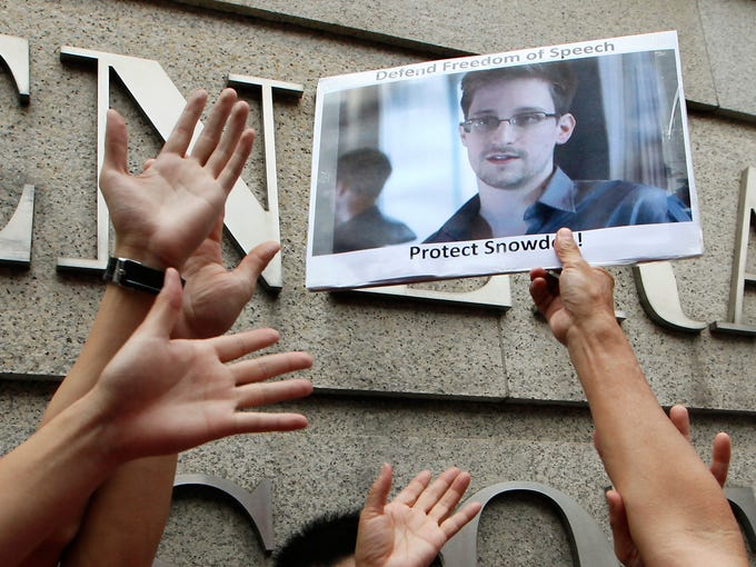 A demonstrator holds a picture of Edward Snowden, a former contractor who leaked top-secret information about U.S. surveillance programs, during a protest outside the U.S. Consulate on June 13 in Hong Kong.