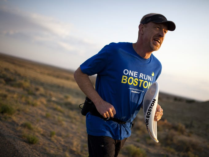 Will Allender  of Fort Collins, Colo., runs uphill at nearly 7000 feet elevation as part of the One Run for Boston relay along  Indian Service Route 9 in New Mexico. The relay, which started June 7 on Venice Beach in the Los Angeles area, ends June 30 in Boston.
