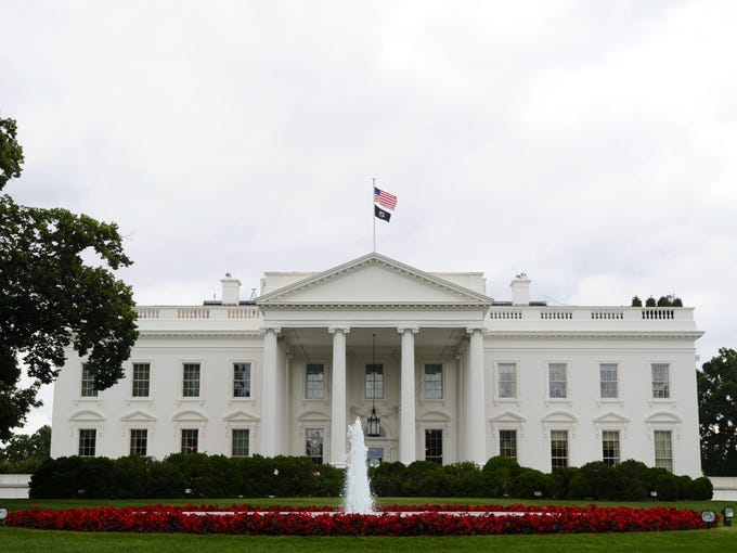 A U.S. flag and a POW flag fly on top of the White House in Washington. Flag Day is celebrated June 14, commemorating the adoption of the flag of the USA, which happened on that day in 1777 by resolution of the Second Continental Congress. The U.S. Army celebrates its birthday on this date as well.
