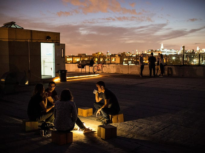 Campers talk and share a meal on the roof of a building on June 15 in the Brooklyn borough of New York City. The makeshift camp is a project of artist Thomas Stevenson titled Bivouac New York, a camp where people are encouraged to turn off their electronic gadgets and focus on exploring outdoor environments within a city context.