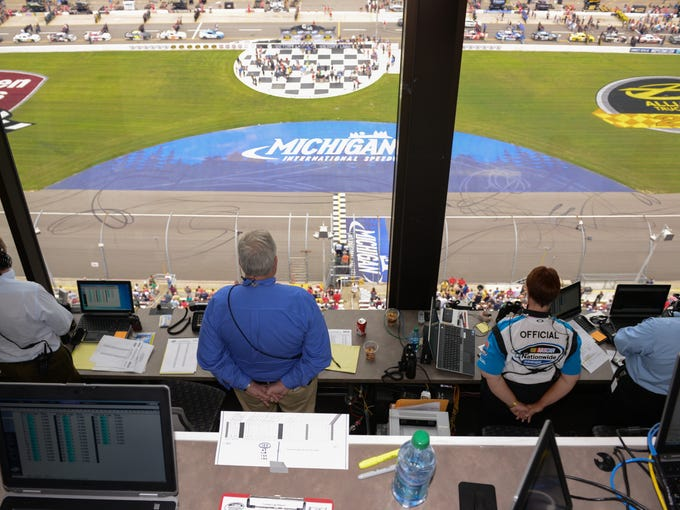 NASCAR officials have a bird's-eye view of a Nationwide Series race from the control booth at Michigan International Speedway.