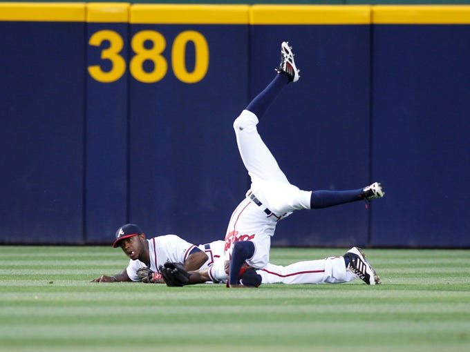 June 18: Braves left fielder Justin Upton and center fielder B.J. Upton collide in the outfield on a fly ball against the New York Mets. B.J. makes the catch.