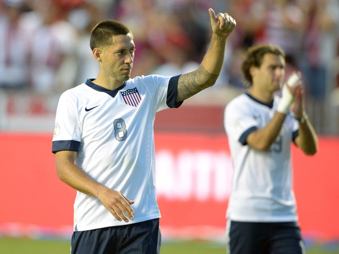 United States midfielder Clint Dempsey (8) celebrates after a FIFA World Cup Qualifier against Honduras at Rio Tinto Stadium.