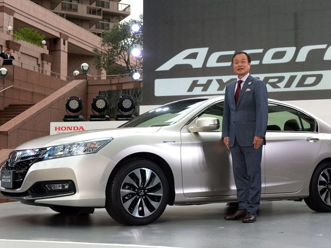 2014 Honda Accord Hybrid is unveiled in Tokyo by the automaker's president, Takanobu Ito