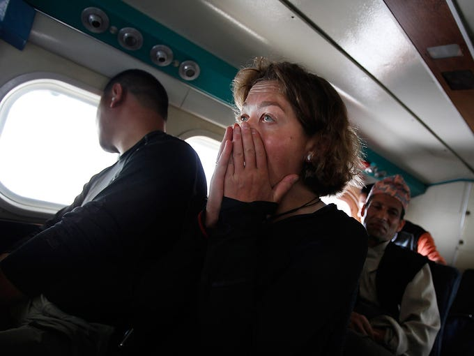 A passenger reacts during turbulence as her flight approaches the airport on May 24 in Lukla, Nepal. Carved out of the side of a mountain, the airport was built by Sir Edmund Hillary in 1965. At an altitude of 9,325 feet, it is one of the most extreme and dangerous airports in the world.