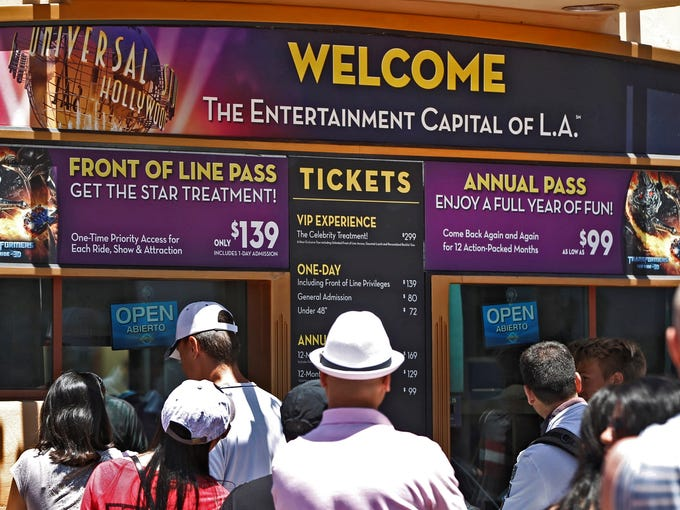 Tourists queue up in the normal line at Universal Studios Hollywood in Los Angeles.
