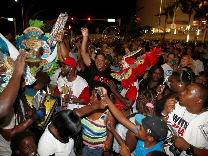 Miami Heat fans celebrate outside the arena following game seven in the 2013 NBA Finals at American Airlines Arena.