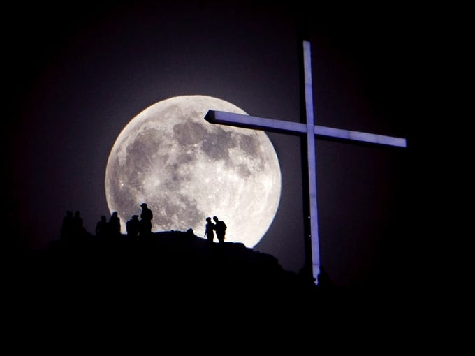 The June 22 so-called supermoon rises over Table Rock and the lighted cross near Boise, Idaho. A supermoon occurs when the moon is closer to Earth than it typically is, and the effect is most noticeable when it occurs at the same time as a full moon, says James Garvin, chief scientist at NASA's Goddard Space Flight Center.