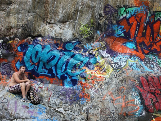 Rocks and cliffs are covered with graffiti near Sapphire Falls in Cucamonga Canyon on June 23 in the Angeles National Forest near Rancho Cucamonga, Calif.