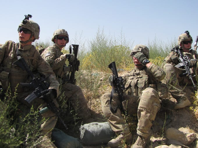U.S. soldiers rest after a foot patrol through a village near Forward Operating Base  Connolly in Nangarhar province. The base was turned over to Afghan forces as part of the ongoing effort to prepare Afghans to assume all security responsibilities ahead of the 2014 U.S. drawdown.