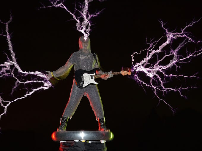 Wang Hongbin, guitarist of the band Lightningfan, is struck by bolts from a Tesla Coil on June 24 in Fuzhou, China. Band members wear metal suits as they play guitars, violins and drums as bolts of lightning crackle around them.