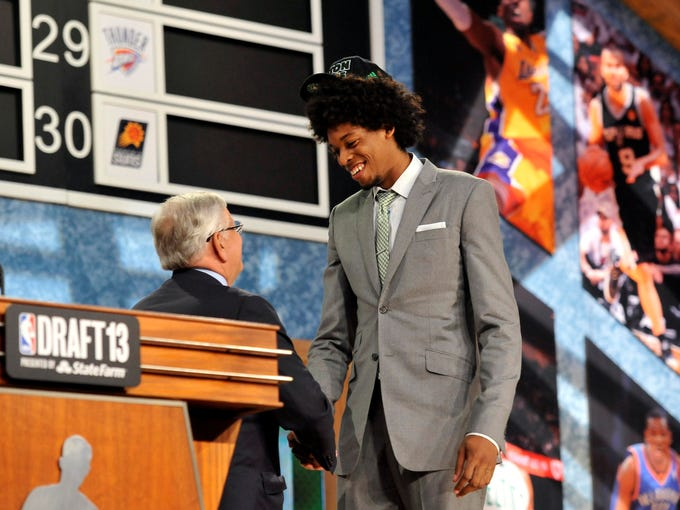 The Boston Celtics selected Lucas Nogueira (photo unavailable) with the 16th pick, who the Mavericks traded for before again trading him to the Atlanta Hawks.