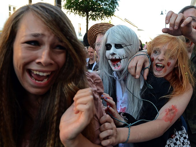 A woman screams as people dressed as zombies stage a tribute to Micheal Jackson's iconic <i>Thriller</i> video on June 29 in Warsaw.