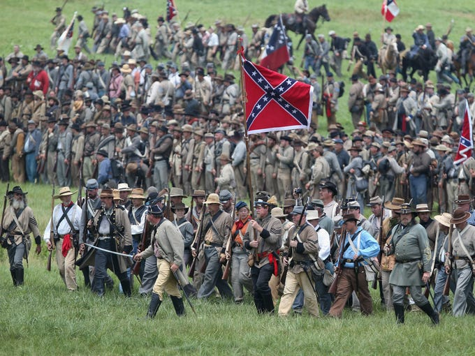 Confederate Civil War re-enactors march toward Union lines during Pickett's Charge on the last day of the Battle of Gettysburg re-enactment. About 8,000 re-enactors from the Blue Gray Alliance participated in the event, marking the 150th anniversary of the Battle of Gettysburg on July 1-3, 1863.