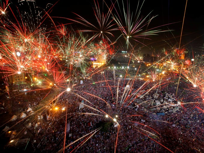 Fireworks light up the sky as opponents of Egypt's ousted president, Mohammed Morsi, celebrate in Tahrir Square on July 3 in Cairo.