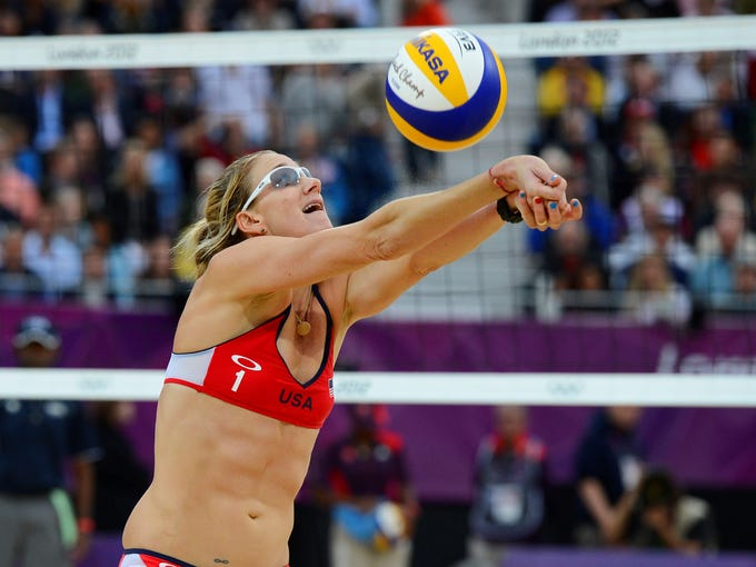 """ESPN The Magazine's annual """"Body Issue"""" features professional athletes tastefully baring all for the cameras. The 2013 issue hits newsstands on July 12, but in the meantime, check out this year's full lineup of athletes. First up:Kerri Walsh Jennings, 34, is a three-time gold medalist in beach volleyball."""