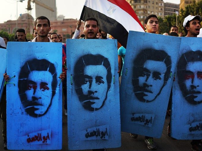 "<p class=""p1""></p><p></p><p></p><p></p><p>Protesters opposed to ousted Egyptian President Mohamed Morsi enter Tahrir Square carrying placards representing people killed during recent demonstrations on July 6, 2013, in Cairo.<br /></p><p><b></b></p>"
